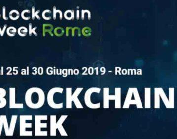 """Cover grafica dell'evento """"Blockchain Week Rome"""" riportante il nome dell'evento e il testo """"dal 25 al 30 Giugno 2019 - Roma BLOCKCHAIN WEEK"""" testo bianco su sfondo blu scuro."""